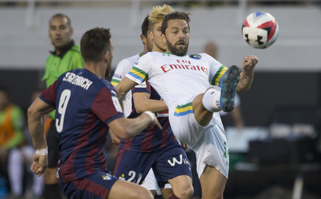 New York Cosmos midfielder Danny Szetela (14) fights for possession with SD Eibar's Sergi Enrich (9) during a friendly between the New York Cosmos and SD Eibar, Wednesday, May 25, 2016, at Sam Boy ...
