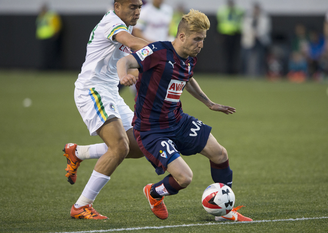 SD Eibar's Keko Gontan (20) breaks free with a New York Cosmos defender on his back during a friendly, Wednesday, May 25, 2016, at Sam Boyd Stadium in Las Vegas. Benjamin Hager/Las Vegas Review-Jo ...