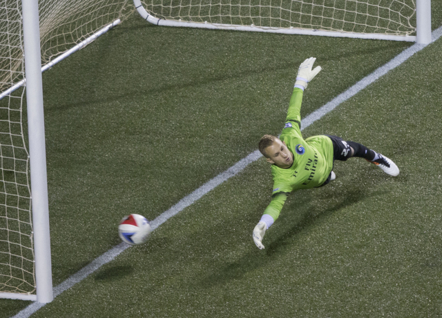 New York Cosmos goalie Brian Holt (24) makes a leaping deflection during a friendly between the New York Cosmos and SD Eibar, Wednesday, May 25, 2016, at Sam Boyd Stadium in Las Vegas. Benjamin Ha ...