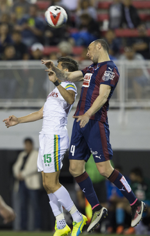 SD Eibar's Ivn Ramis (4) fights for a ball with New York Cosmos' Ruben Bover (15) during a friendly between the New York Cosmos and SD Eibar, Wednesday, May 25, 2016, at Sam Boyd Stadium in Las Ve ...
