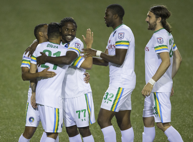 New York Cosmos' Lucky Mkosana (77) celebrates with teammates after after beating SD Eibar, Wednesday, May 25, 2016, at Sam Boyd Stadium in Las Vegas. Benjamin Hager/Las Vegas Review-Journal