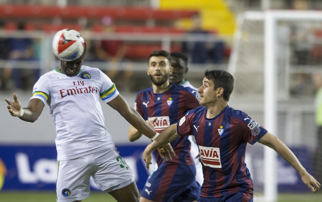 New York Cosmos defender Kwame Watson-Siriboe (32) heads a ball away from SD Eibar's Junca Rene (17) during a friendly between the New York Cosmos and SD Eibar, Wednesday, May 25, 2016, at Sam Boy ...