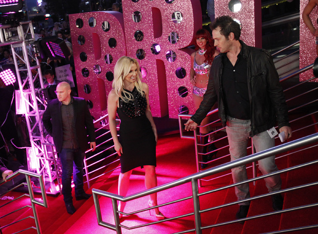 Britney Spears walks up the stairs to Planet Hollywood in Las Vegas Tuesday, Dec. 3, 2013 to promote her new show at the casino. (John Locher/Las Vegas Review-Journal)