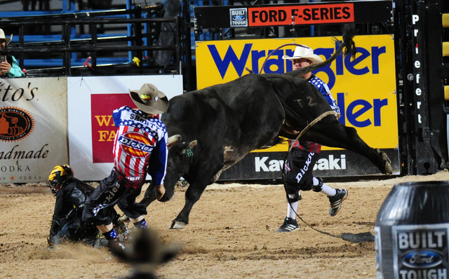 Bull rider Jess Lockwood rides Pitch Black to a score of 84.5 during the Professional Bull Riders Last Cowboy Standing at the Las Vegas Village grounds in Las Vegas Friday, May 13, 2016. (Josh Hol ...