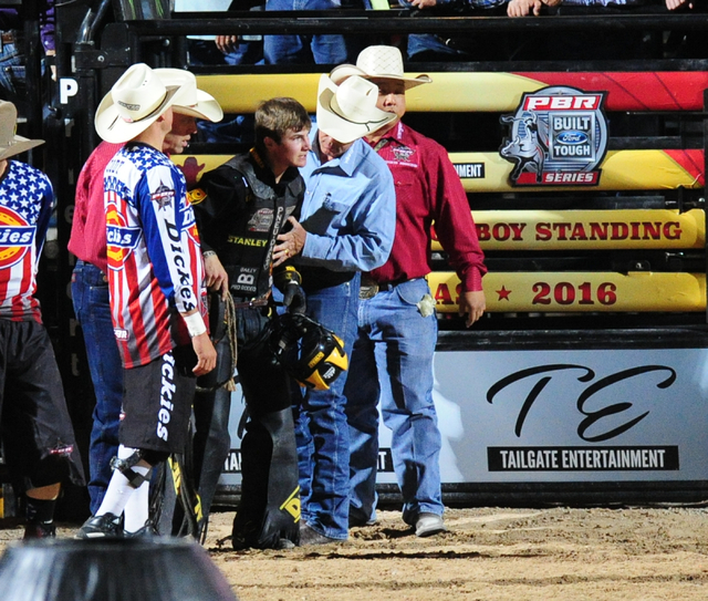 Bull rider Jess Lockwood is helped off the arena floor after riding Pitch Black to a score of 84.5 during the Professional Bull Riders Last Cowboy Standing at the Las Vegas Village grounds in Las  ...
