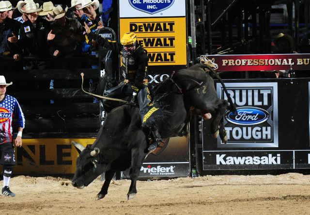 Bull rider Jess Lockwood rides Pitch Black to a score of 84.5 during the Professional Bull Riders Last Cowboy Standing at the Las Vegas Village grounds in Las Vegas Friday, May 13, 2016.  (Josh Ho ...