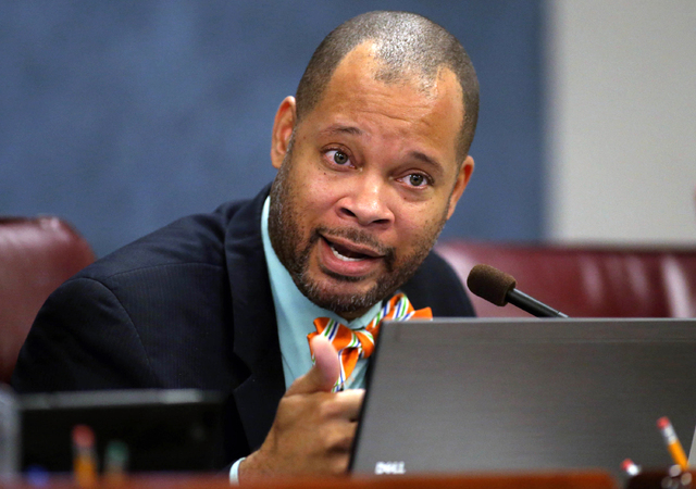 Nevada state Sen. Aaron Ford, D-Las Vegas, works in committee at the Legislative Building in Carson City in 2015. (Cathleen Allison/Associated Press)