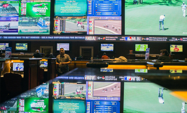 Television monitors reflect off a countertop at the Green Valley Ranch race and sports book on Thursday, May 12, 2016. The resort has added ultra-high-definition LED displays at the sports book. J ...