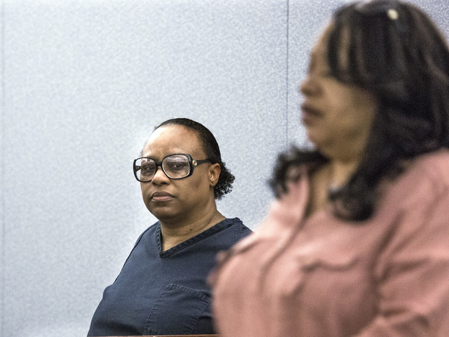 Convicted murder Brenda Stokes Wilson, left, looks at Tejuana Reeves, mother of murder victim 10-year-old Jade Morris, while she walks toward the stand to make a victim statement at Regional Justi ...