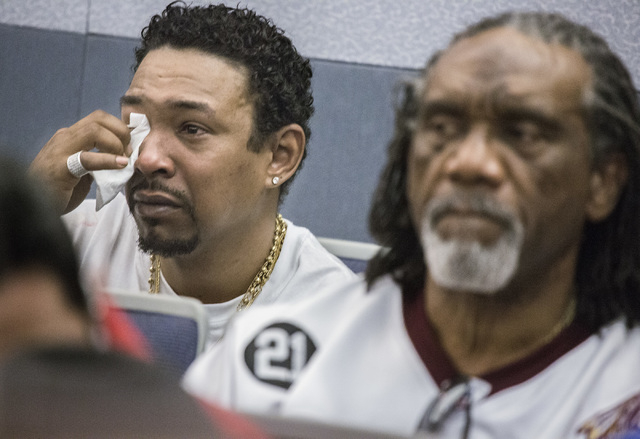 Philip Morris, left, father of murder victim 10-year-old Jade Morris, wipes tears during the sentencing of Brenda Stokes Wilson at Regional Justice Center on Monday, May 16, 2016.  Jeff Scheid/Las ...