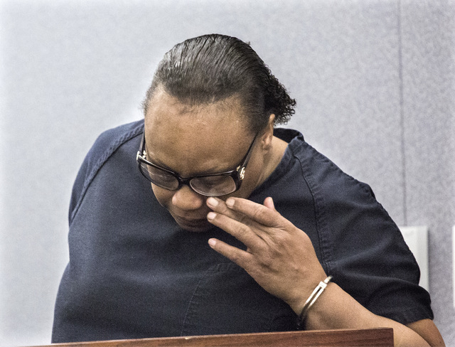 Brenda Stokes Wilson, convicted of killing a 10-year-old girl and slashing a Bellagio blackjack dealer, wipes tears during her sentencing at Regional Justice Center on Monday, May 16, 2016. She re ...
