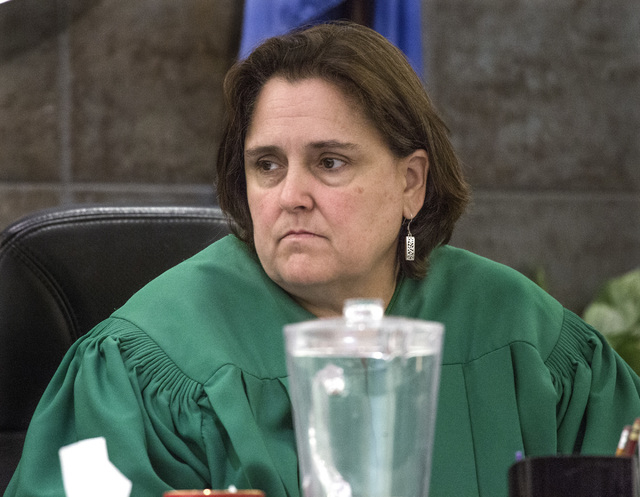 District Judge Kathleen Delaney listens while Philip Morris, father of murder victim 10-year-old Jade Morris, makes a victim's statement in the sentencing of convicted murder Brenda Stokes Wilson  ...