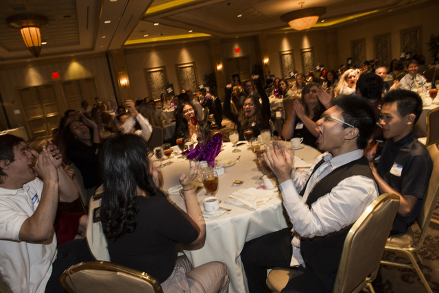 Spring Valley High School student journalists, including Landon Pham, second from right, react after placing first in the general excellence category in the Clark County High School Journalism Awa ...