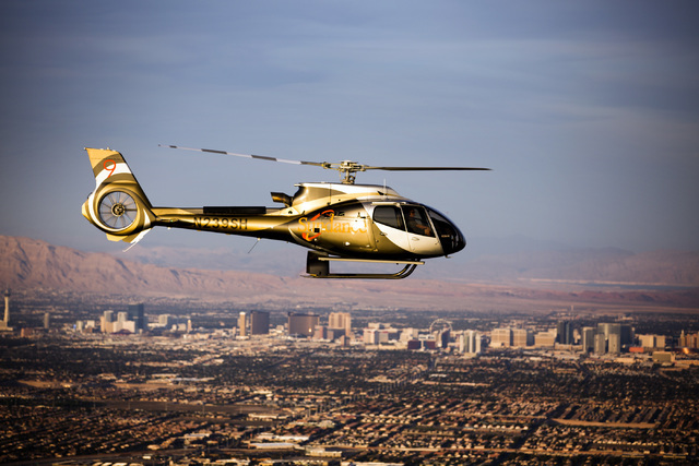 A Sundance EC130T2 helicopter flies near Red Rock Canyon with the view of Las Vegas in the background. Sundance Helicopters introduced the new Red Rock Helicopter Tour. Jeff Scheid/Las Vegas Revie ...