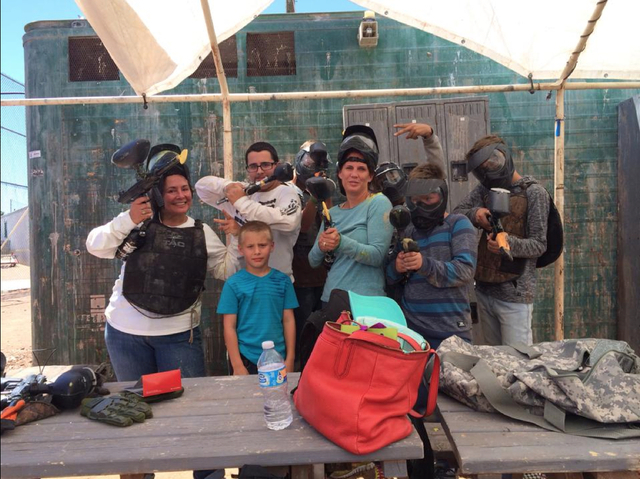 Laurie Perry, left, helps her sister, Danielle Guy, center, at a paintball birthday party. When Guy's husband died, Perry welcomed her sister and her nephews — Jared, in white, Carson, center fr ...