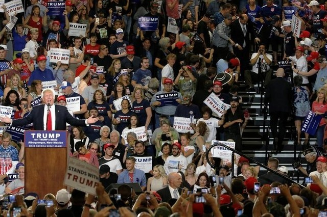 A protester (R) disrupts a rally with Republican U.S. presidential candidate Donald Trump and his supporters in Albuquerque, New Mexico, U.S. May 24, 2016. (Jonathan Ernst/Reuters)