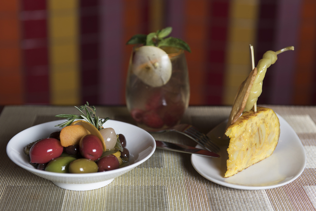Marinated olives, left, Spanish tortilla, right, and a white sangria are seen at Julian Serrano Tapas at the Aria hotel-casino in Las Vegas Wednesday, April 13, 2016. Jason Ogulnik/Las Vegas Revie ...