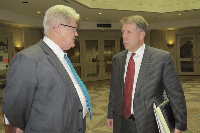State Controller Ron Knecht, left, talks with attorney Craig Mueller outside the Nevada Supreme Court chambers on Monday, May, 2, in Carson City. Knecht is leading a referendum effort to repeal Ne ...