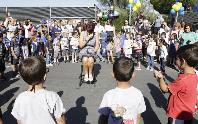 Kindergarten teacher, Janet Manfredi, center, gets emotional as her students and their parents gathered during a surprise farewell and Good Luck ceremony at St. Viator School on Wednesday, May 25, ...