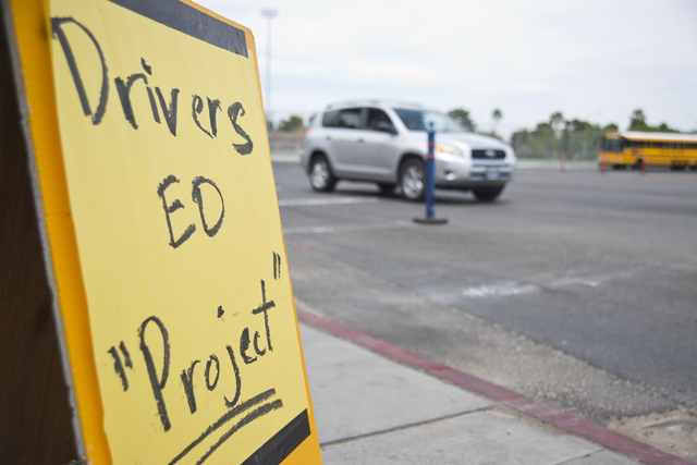 A sign stands near the curb of a Valley High School parking lot in Las Vegas where driver's education instructor Mike Grady was teaching his students how to parallel park  on Friday, May 20, 2016. ...