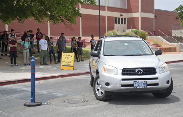 Driver's education instructor Mike Grady demonstrates parking techniques at Valley High School in Las Vegas on Friday, May 20, 2016. (Daniel Clark/Las Vegas Review-Journal) Follow @DanJClarkPhoto