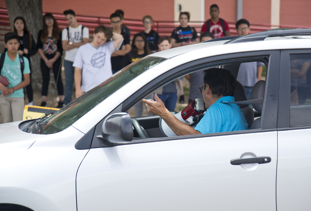 Driver's education instructor Mike Grady uses a loudspeaker as his teaches his students how to parallel park a car at Valley High School in Las Vegas on Friday, May 20, 2016. (Daniel Clark/Las Veg ...