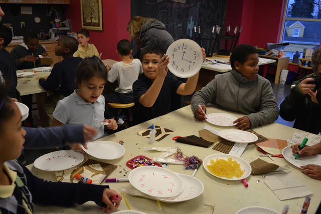 Youths at the Boys & Girls Clubs of Southern Nevada show off their time-telling skills Feb.15, 2016. Boys & Girls Clubs and DiscountWatchStore.com taught more than 100 children in Las Vega ...