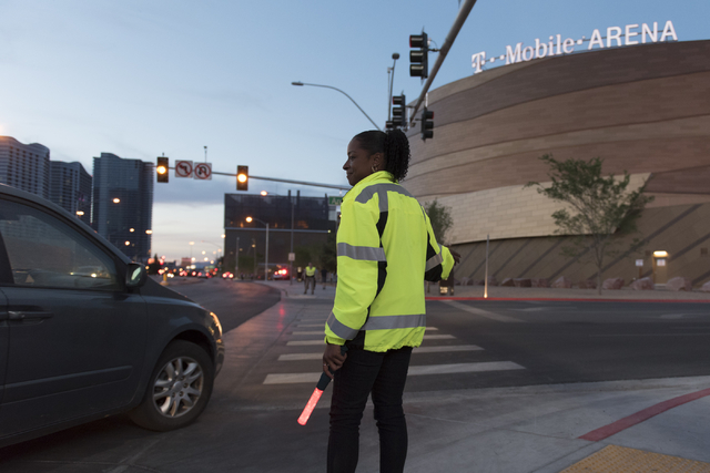 LaTia Goree of Las Vegas Traffic Control directs traffic to arena parking from Frank Sinatra Drive during T-Mobile Arena's opening day in Las Vegas Wednesday, April 6, 2016. ( Jason Ogulnik/Las Ve ...