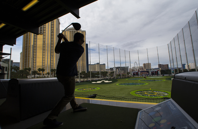 Beau Ventling of Las Vegas drives the ball at Topgolf during a family and friends day ahead of the official opening in Las Vegas on Tuesday, May 17, 2016. Topgolf, which spans four levels and 105, ...