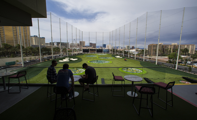 People explore Topgolf during a family and friends day ahead of the official opening in Las Vegas on Tuesday, May 17, 2016. Topgolf, which spans four levels and 105,000 square feet, opens to the p ...