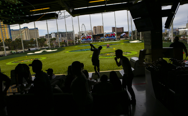 People play and relax at Topgolf during a family and friends day ahead of the official opening in Las Vegas on Tuesday, May 17, 2016. Topgolf, which spans four levels and 105,000 square feet, open ...