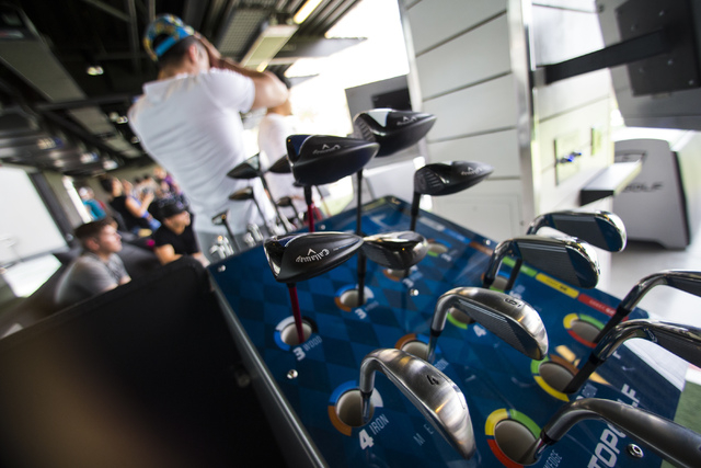 Golf clubs are shown at Topgolf during a family and friends day ahead of the official opening in Las Vegas on Tuesday, May 17, 2016. Topgolf, which spans four levels and 105,000 square feet, opens ...