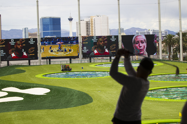 A man hits a ball at Topgolf during a family and friends day ahead of the official opening in Las Vegas on Tuesday, May 17, 2016. Topgolf, which spans four levels and 105,000 square feet, opens to ...