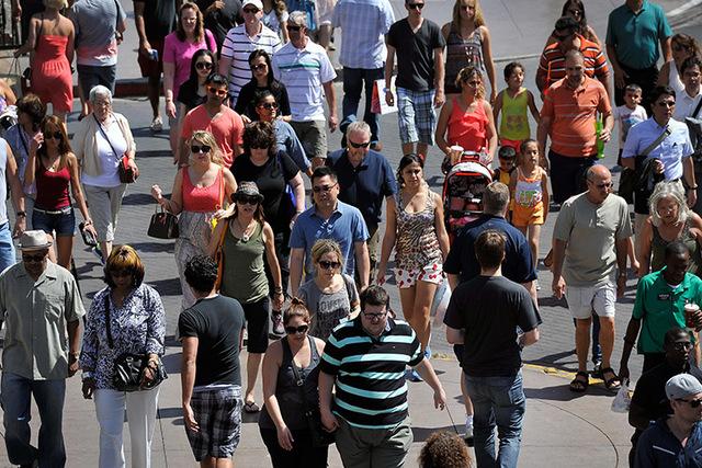 Tourists walk along the Strip on Tuesday, June 17, 2014. (David Becker/Las Vegas Review-Journal)
