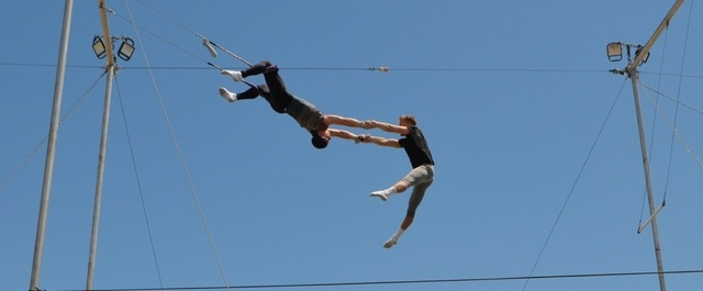 Christopher Ries catches Anthony Patrick Delaney during a Trapeze Las Vegas demonstration on Bob Christians Day May 1, 2016. Ginger Meurer/Special to View