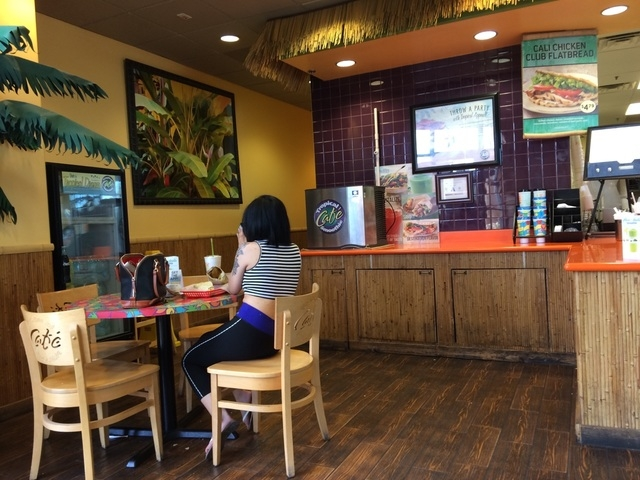 The interior of the Tropical Smoothie Cafe at 7660 W. Cheyenne Ave., Suite 121, features a Polynesian theme with faux palm trees, bamboo and thatched roof accents. Jan Hogan/View