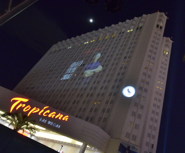 Chef Robert Irvine, in spotlight, rappels down the side of the Tropicana hotel-casino prior to an announcement that he will open a new restaurant at the property at 3802 Las Vegas Blvd. South on M ...