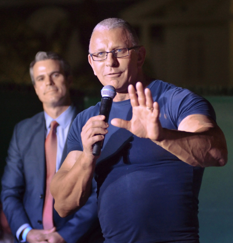 Eric Schippers, senior vice president at Penn National Gaming, left, listens to chef Robert Irvine during an announcement that Irvine will open a new restaurant at the Tropicana hotel-casino durin ...