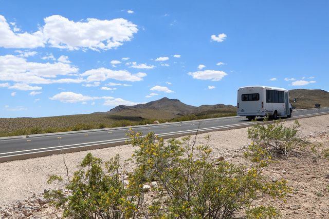 A City of Henderson shuttle bus is seen on the first paved access road to Sloan Canyon National Conservation Area on Thursday, May 19, 2016. The BLM Thursday dedicated the road and other visitor a ...