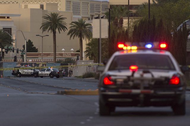 Las Vegas police close a portion of Fashion Show Drive, on the South side of Trump International, where a man is threatening to jump from the tower in Las Vegas Friday, May 13, 2016. ( Jason Oguln ...