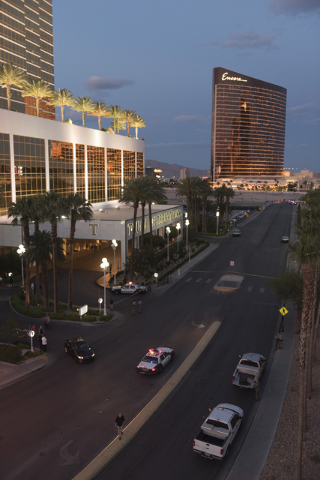 Las Vegas police close a portion of Fashion Show Drive, on the South side of Trump International, where a man is threatening to jump from the tower in Las Vegas Friday, May 13, 2016.( Jason Ogulni ...
