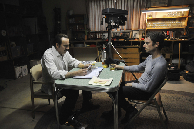 """Nicolas Cage, left, and Elijah Wood star in """"The Trust."""" (Courtesy of Saban Films, Lionsgate and DirecTV)"""