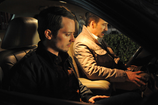 """Elijah Wood, left, and Nicolas Cage star in """"The Trust."""" (Courtesy of Saban Films, Lionsgate and DirecTV)"""