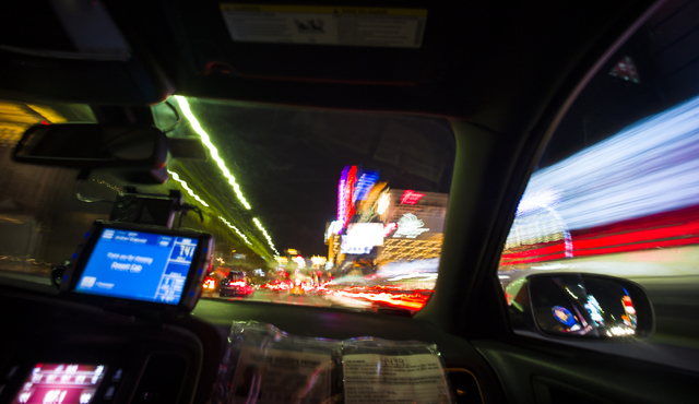 Desert Cab taxi driver Andrew Gnatovich drives passengers along the Las Vegas Strip on Wednesday, May 4, 2016. Chase Stevens/View Follow @csstevensphoto
