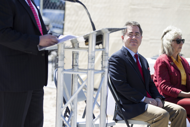 """UNLV President Len Jessup, and Congresswoman Dina Titus, D-Nev., listen to Eric Midby, CEO for Midby Companies, during the groundbreaking ceremony for a 756-bed building, """"U District,&amp ..."""