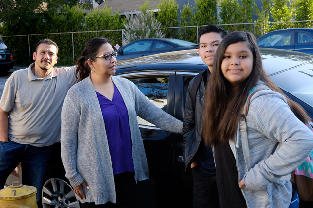 Enrique Duarte, left, with his wife Lisette and their two children Enrique and Elise before taking them to school in Los Angeles in May 2016. Richard Vogel/The Associated Press)