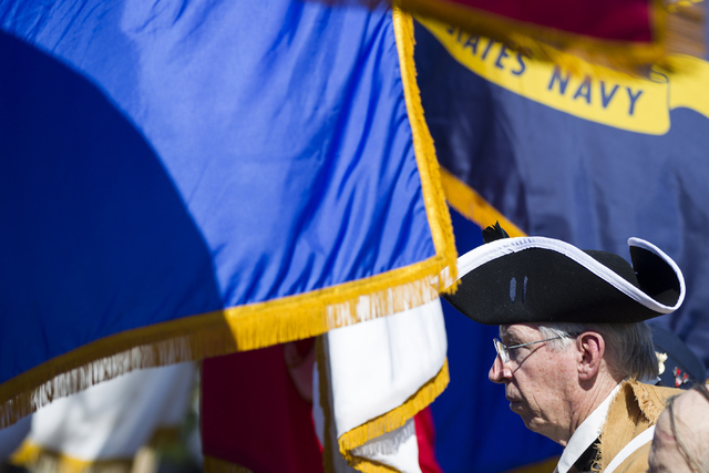 Gary Parriott, Army veteran from the Cold War era, listens to the singing of the national anthem during the Nevada Veterans Memorial dedication ceremony at the Grant Sawyer Building on Friday, May ...