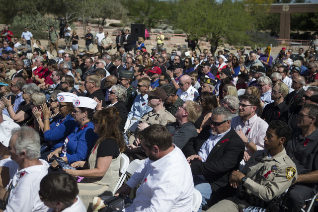 Attendees listen during the Nevada Veterans Memorial dedication ceremony at the Grant Sawyer Building on Friday, May 27, 2016, in Las Vegas. Erik Verduzco/Las Vegas Review-Journal Follow @Erik_Ver ...
