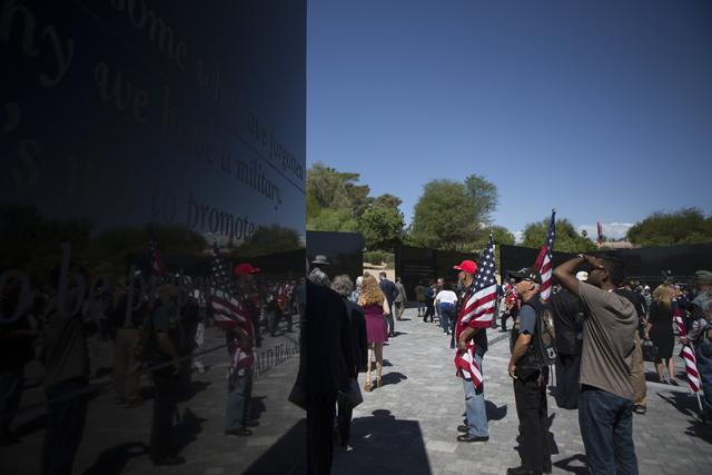 Attendees tour the Nevada Veterans Memorial following the dedication ceremony at the Grant Sawyer Building on Friday, May 27, 2016, in Las Vegas. Erik Verduzco/Las Vegas Review-Journal Follow @Eri ...