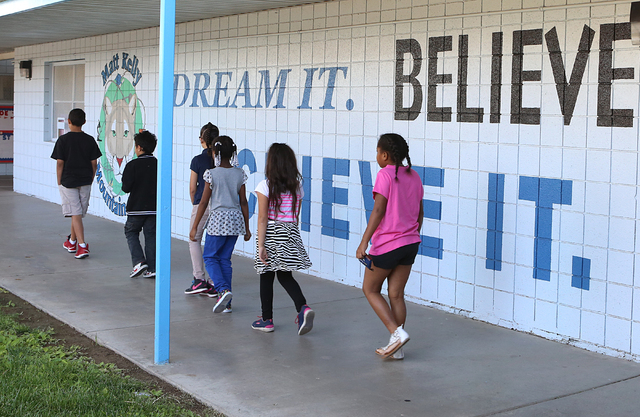 Kelly Elementary School students walk to their class Friday, April 29, 2016, in North Las Vegas. The Clark County School District recently removed and replaced the principal at Matt Kelly School.  ...